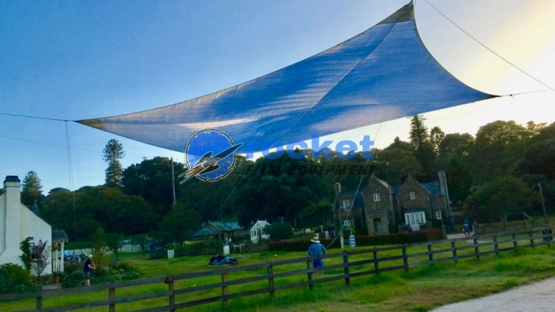 Lighting Control Equipment. Tensioned Diffusion Sail for the Peter Rabbit Film Shoot flying in position as the sun goes down